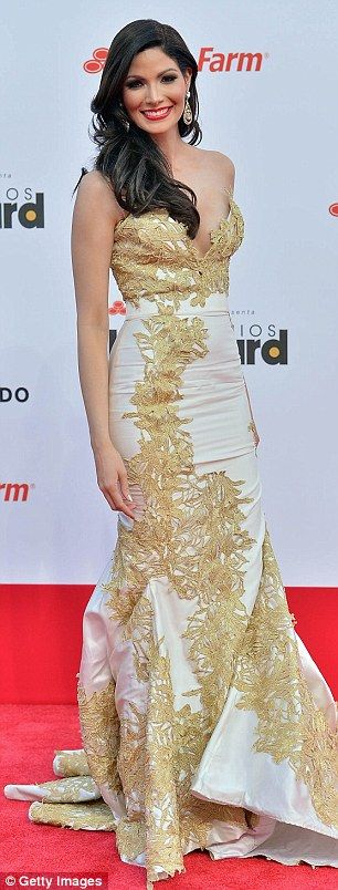 This gold and ivory gown is so amazing