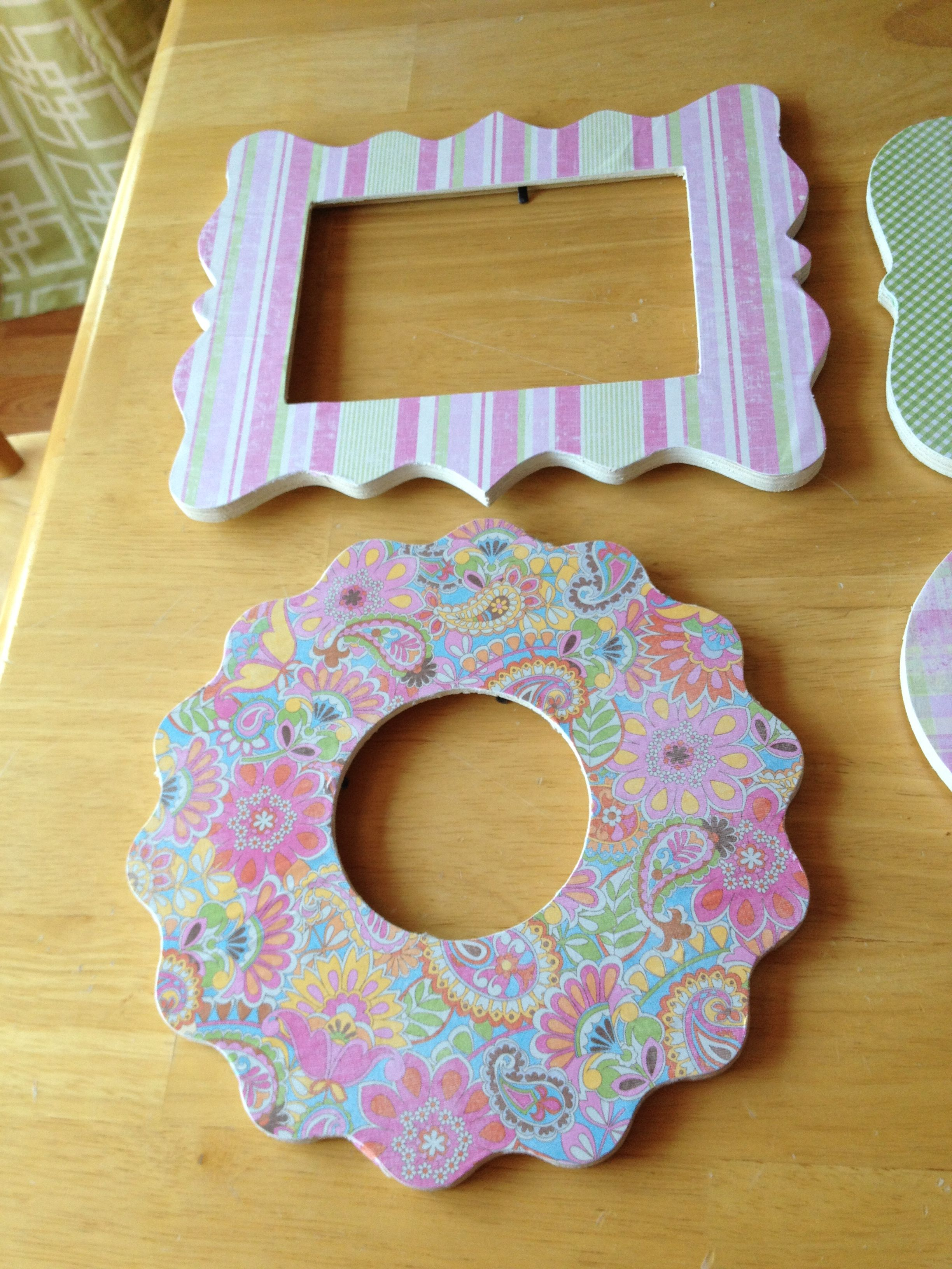 Inexpensive frames from Michael's covered in scrapbook paper... Super easy and cute.