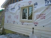 A Wall Retrofit Showing The Tyvek Exterior Weather Barrier Used To Contain Cellulose Insulation
