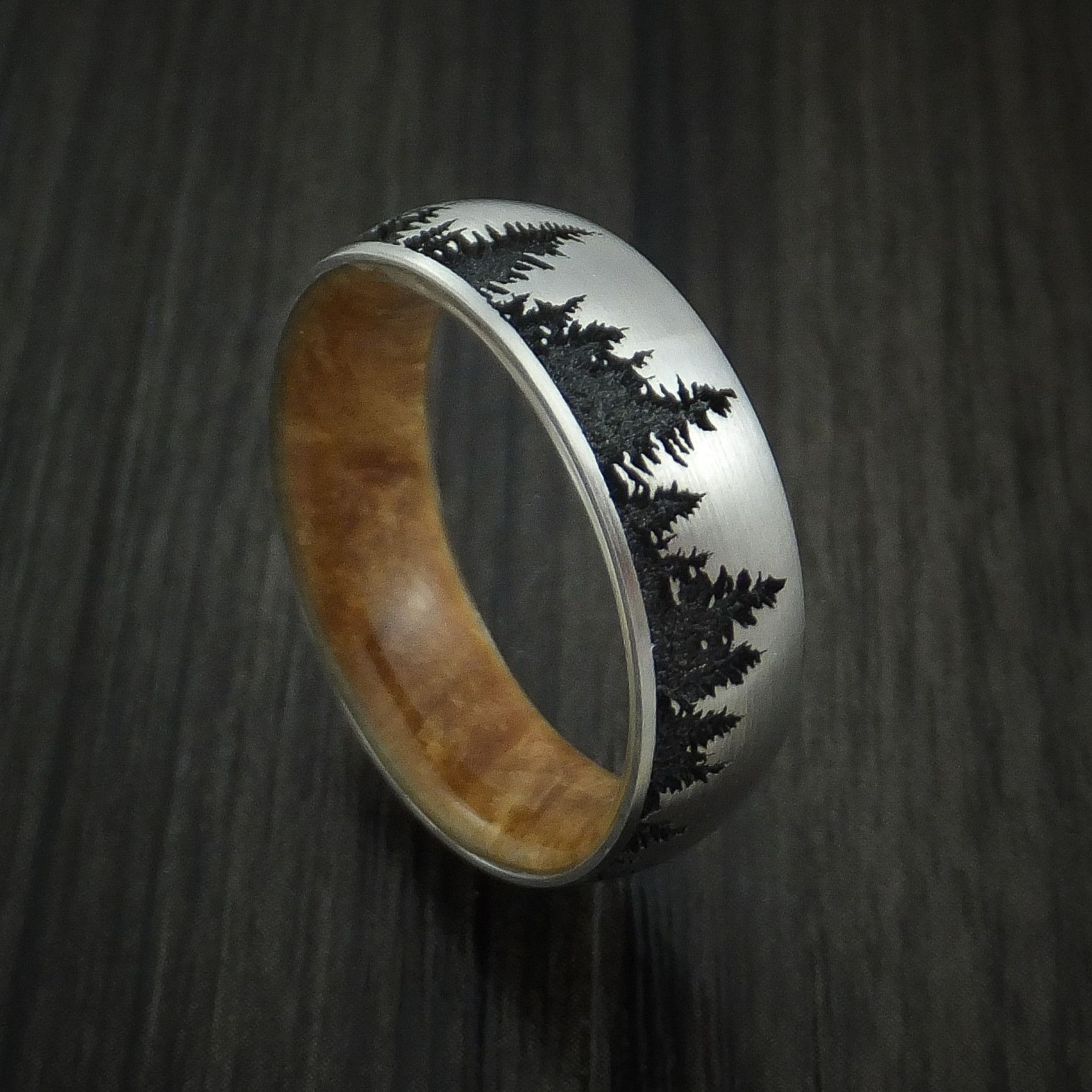 Titanium ring with tree design and maple burl hardwood sleeve custom