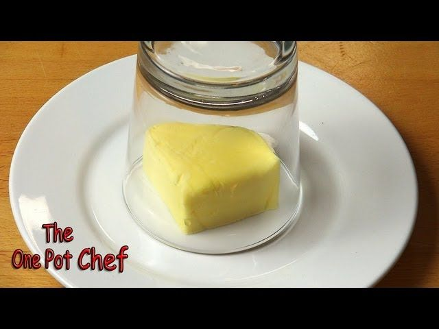 Cut the amount of butter you want to use and put it on a plate. Grab a glass and fill it with hot water. Let it rest for a minute or till the glass outside is warm. In quick succession, tip the water out of the glass, dry it and invert it over the chunk of butter. In a minute or so, you'll have beautifully soft butter.