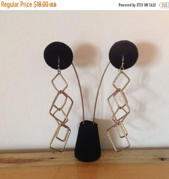 Christmasinjuly Gold dangling, shoulder duster earrings in an Geometric design