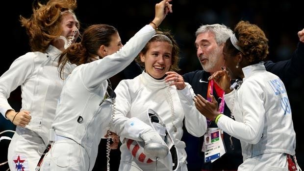 Courtney Hurley (center) of the United States and teammates Susannah Scanlan (left), Kelley Hurley (2nd left), Maya Lawrence (right) and head coach Roberto Sobalvarro (2nd right) celebrate winning the Bronze Medal Match 31-30 against Russia during the Women's Epee Team Fencing Finals on Day 8 of the London 2012 Olympic Games at ExCeL on August 4, 2012 in London, England. (Photo by Hannah Johnston/Getty Images)