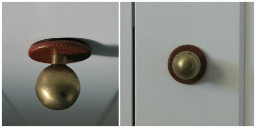metal knobs with leather surrounds from anthropologie. there's got to be a way to DIY this