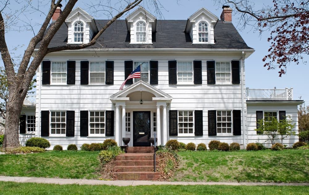 Classic White Colonial Home With Black Shutters With Three Handsome Dormer Windows In The Gabled Roof On The Th In 2020 Colonial House House Styles House Exterior Blue