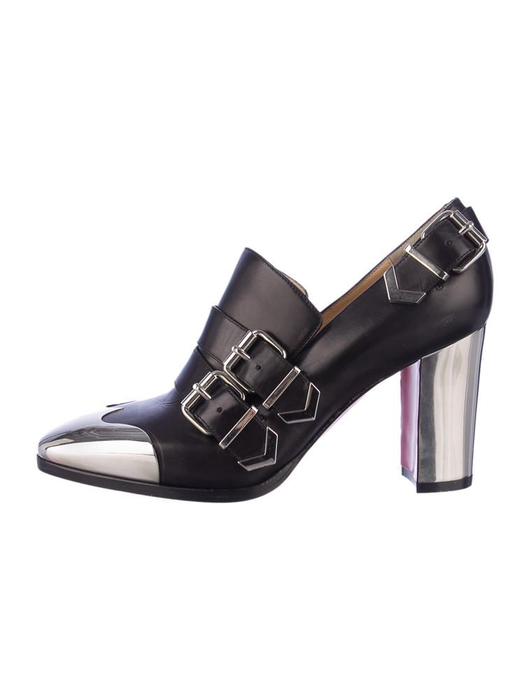 Black and silver Christian Louboutin leather Anita booties with mirrored metal detail at toe and heel, silver-tone hardware and buckle details at back and top vamp. $595.00 size 6.5