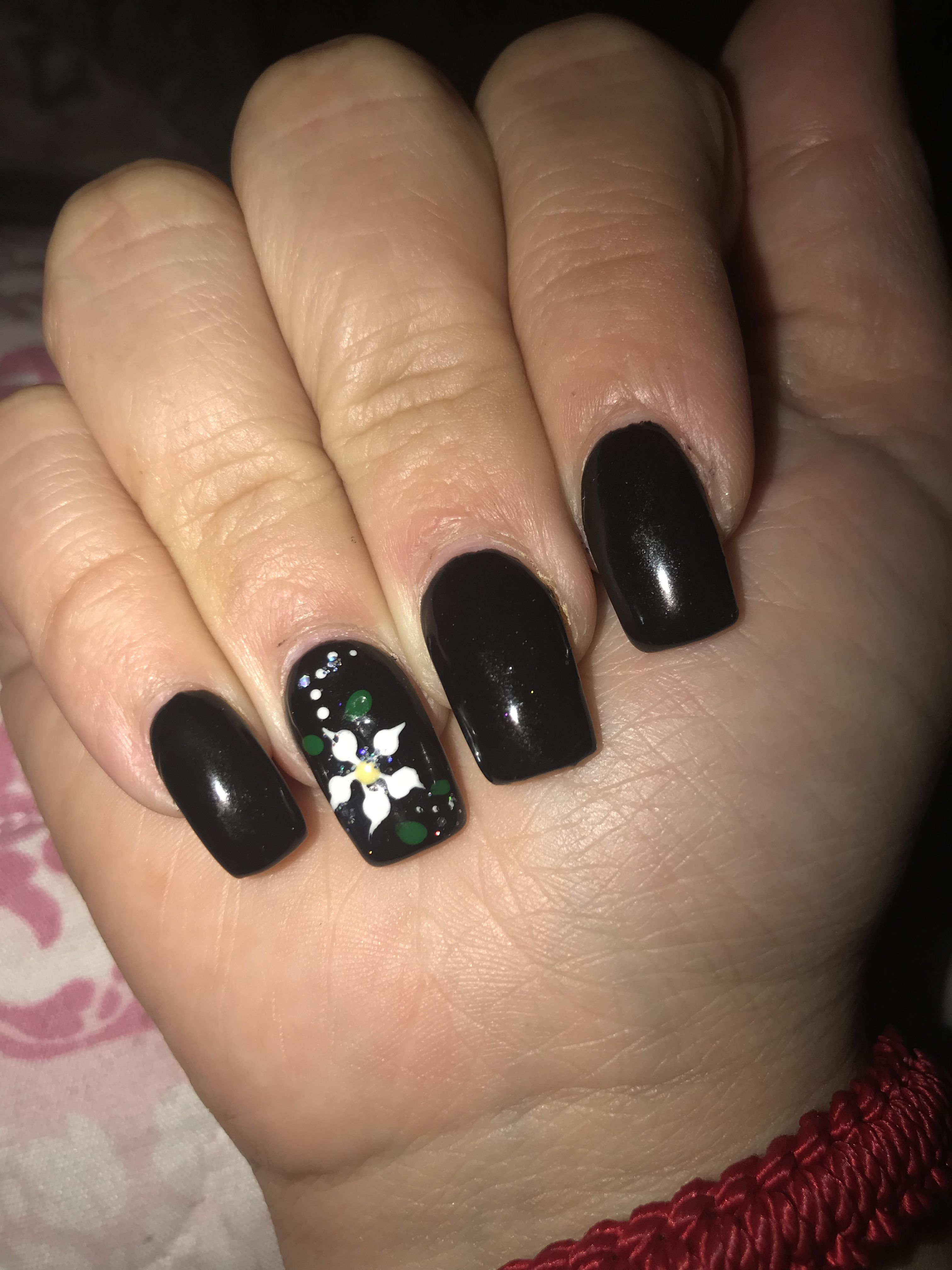 Black nails with flower. Something neutral for Halloween ...