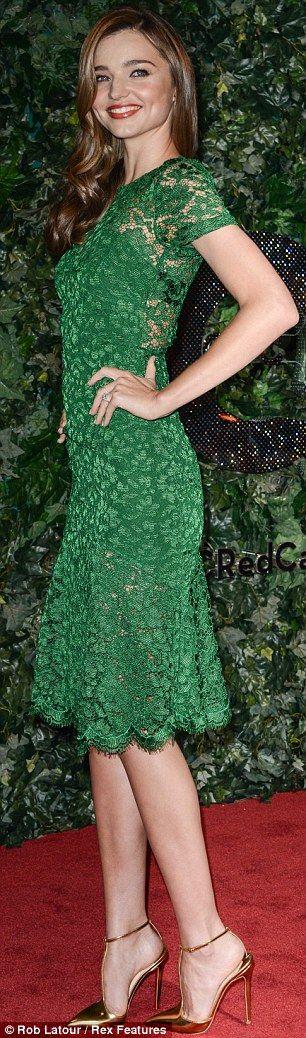 Elegant in emerald! Miranda Kerr goes green as she does a twirl at ...