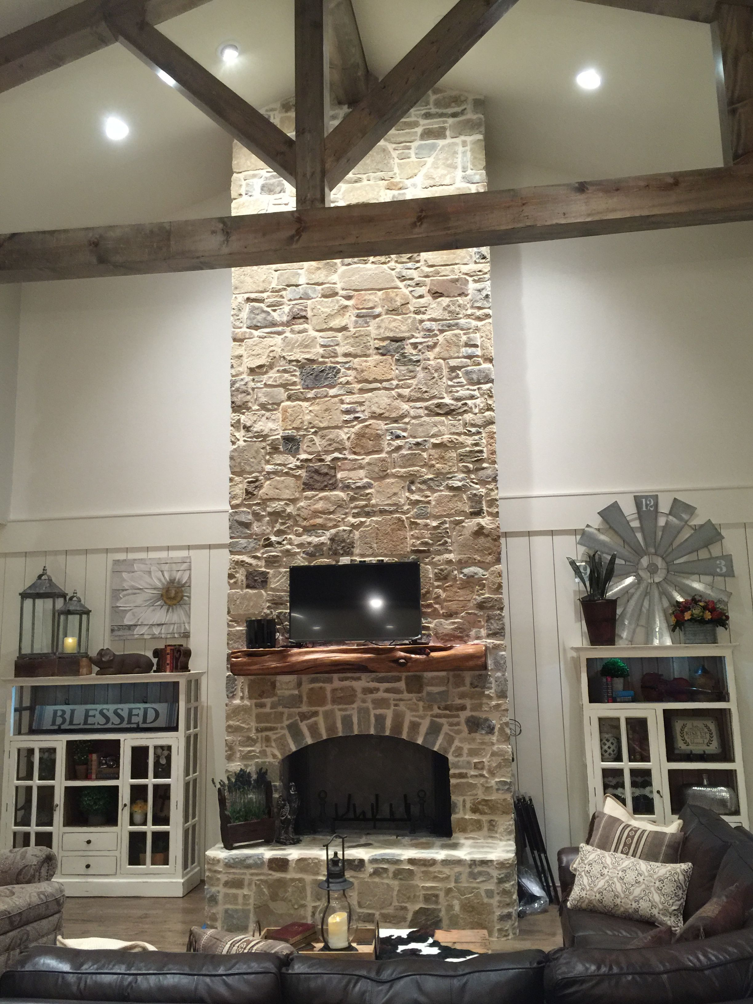 Grand Rock Fireplace In Farmhouse Great Room White Hutches On White Shiplap Walls Transitional House Transitional Fireplaces Transitional Decor