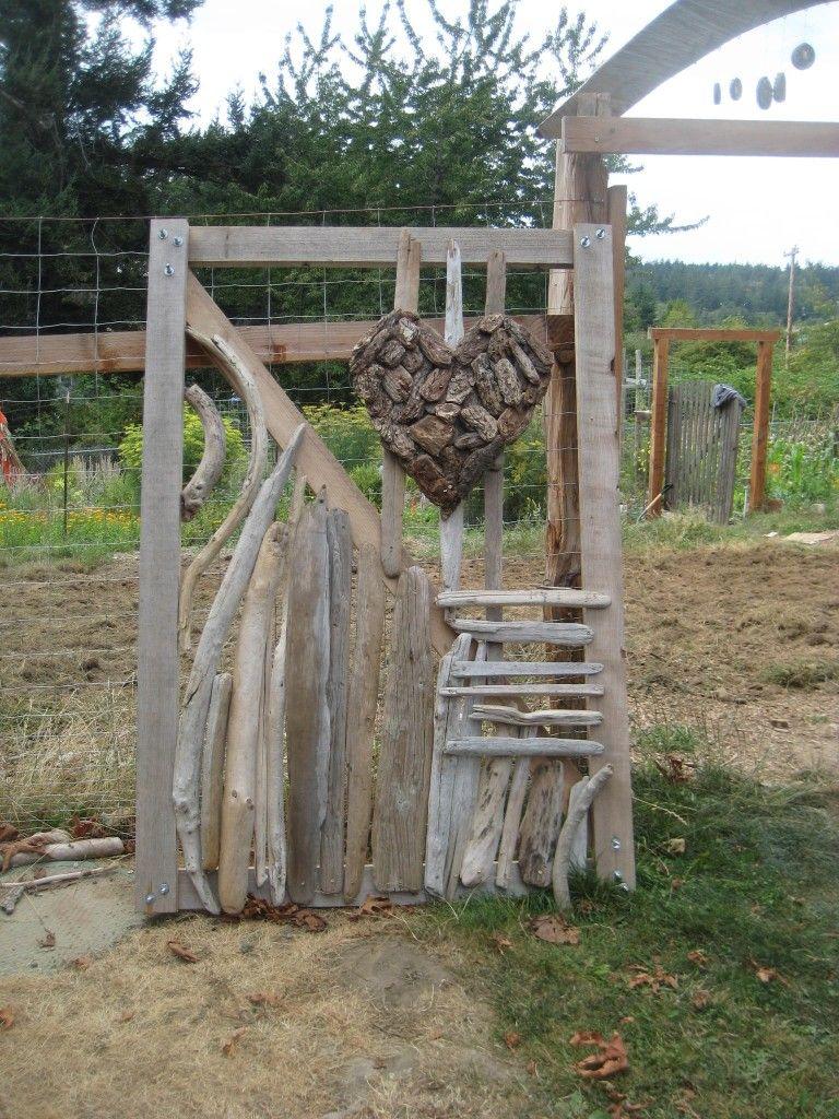 Driftwood designs and a bark heart adorns the garden gate ...