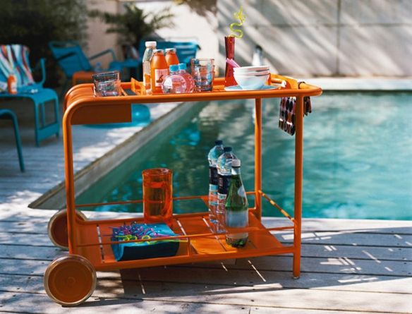 Paint color inspiration for that old metal/glass table... #barcart #orange #outdoor