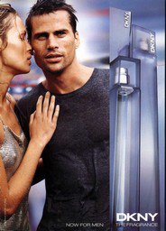 "This is DKNY perfume advertisement which again shows that by using the perfume, guys become more appealing. By the face of the girl, she looks as if she is smelling him and is attracted to it. This implies that women focus on men's smell rather than their body since the guy is wearing a shirt covering his fit body(six pack) to prove it. The quote saying ""Now For Men"" tells us that since it was for women, women would be likely to like the smell thus men would take advantage of this and buy…"
