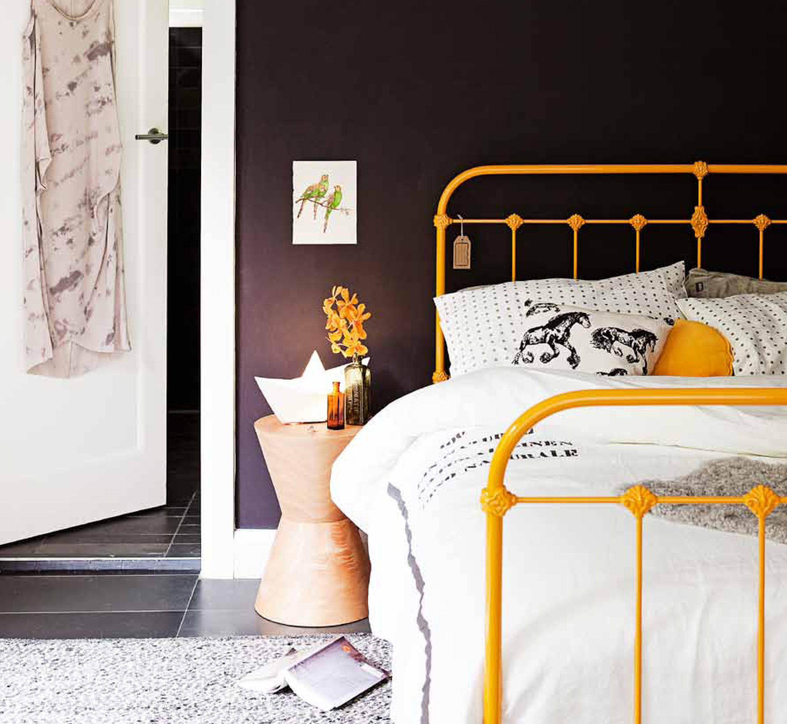 Wrought Iron Bed With A Twist! Yellow Really Pops Against Black Wall  #lifeinteriors