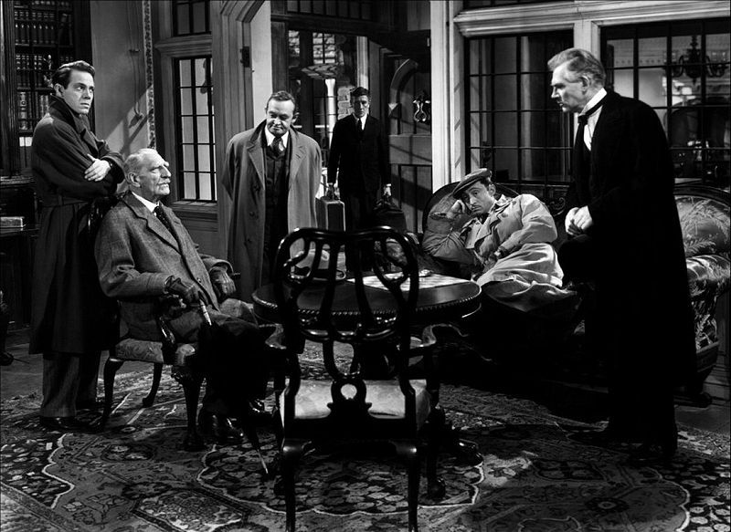 """'And Then There Were None' (1943) play by """"Agatha Christie"""" based on her 1939 book.10 guests who have never met each other or their absent host are lured to an island & marooned.A mysterious voice accuses each of having gotten away w/ murder & then one drops dead---poisoned.One down & 9 to go!Toy soldiers on the mantel fall to the floor & break one by one as those in the house succumb to a diabolical avenger.A nursery rhyme tells how each of the ten """"soldiers"""" met his death until there were…"""