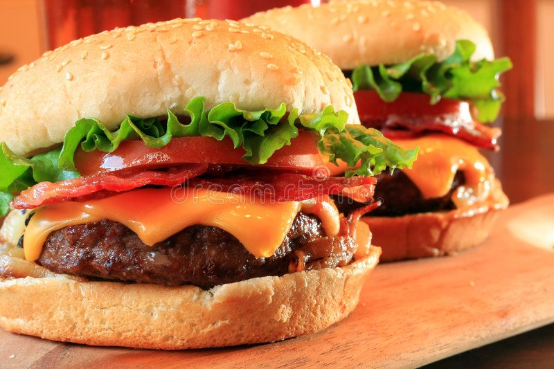 Bacon cheeseburgers. Juicy and delicious bacon cheddar cheeseburgers ,