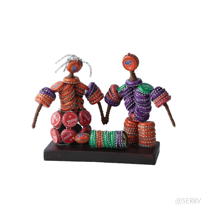 Not your grandmother's nativity! Recycled soda caps are cleverly assembled to create these brightly colored figures, affixed to a dark wooden base. #FairTrade