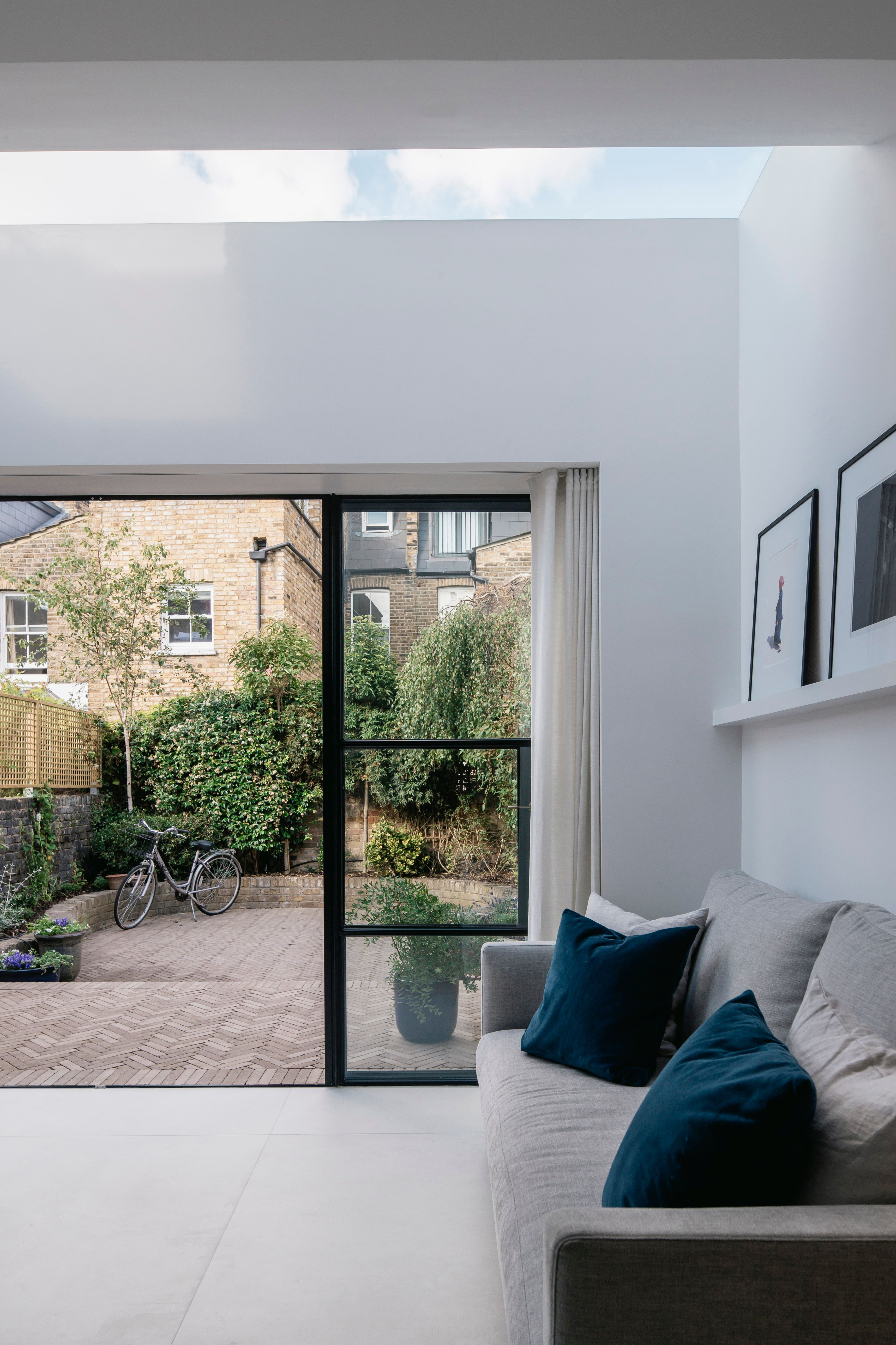 Crittall Style Windows With Frameless Skylight And Recessed Curtain Track Oliver Leech Architects S Residential Architecture Bungalow Renovation Parsons Green
