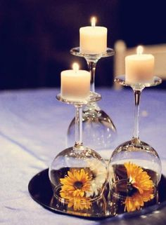Wine Glasses Flipped Upside Down With Candles On Top And Flower Underneath.  Super Cheap DIY Awesome Design
