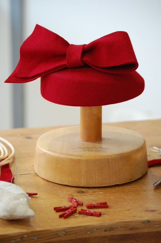 A red Bow on a simple hat