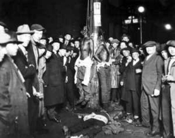 """June 15, 1920. Duluth, Minnesota. Text from """"Without Sanctuary: Lynching Photography in America"""": 'Six black circus workers, alleged to have assaulted a white girl, were dragged from their cells in a Duluth, Minnesota, jail by a mob of five thousand people. Twelve policemen were injured during the attack. In an impromptu trial, orchestrated by the mob leaders, three of the suspects were """"found not guilty."""" The three """"found guilty"""" were hanged. An investigation by the civic authorities proved…"""