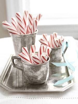 Love the classic look of peppermint sticks in silver cups.