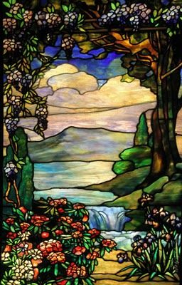 Landscape with waterfall [1920s]..   This window demonstrates how Tiffany's craftsmen manipulated several kinds of glass to create extraordinary naturalness..  - Motted Glass - recreate intense sunlight as filtered through the leaves of the trees  - Striated glass evokes movement of the water in the foreground  - Playing several layers of colored glass in the reverse create the impression of distant, misty mountain peaks