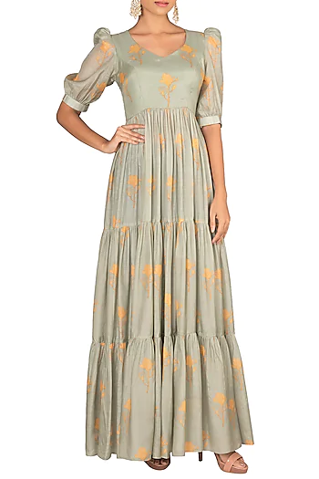 Featuring a mint green layered maxi dress in cotton silk