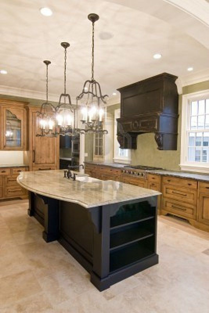 Island with curved granite top maybe allows a little more ...