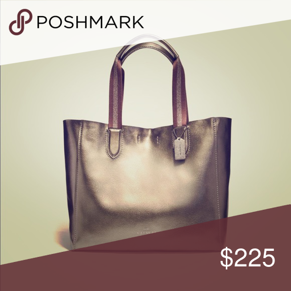 3c49b538ff268b Coach Large Derby Tote NWT This gorgeous bag has plenty of room for  everything you need! Metallic pebble leather. Inside zip pocket. Snap  closure. Color is ...