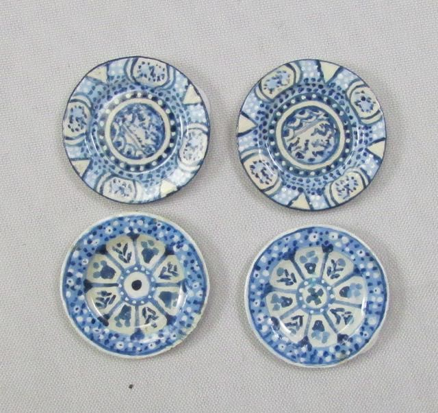 a selection of 2 pairs of blue and white plates great for wall