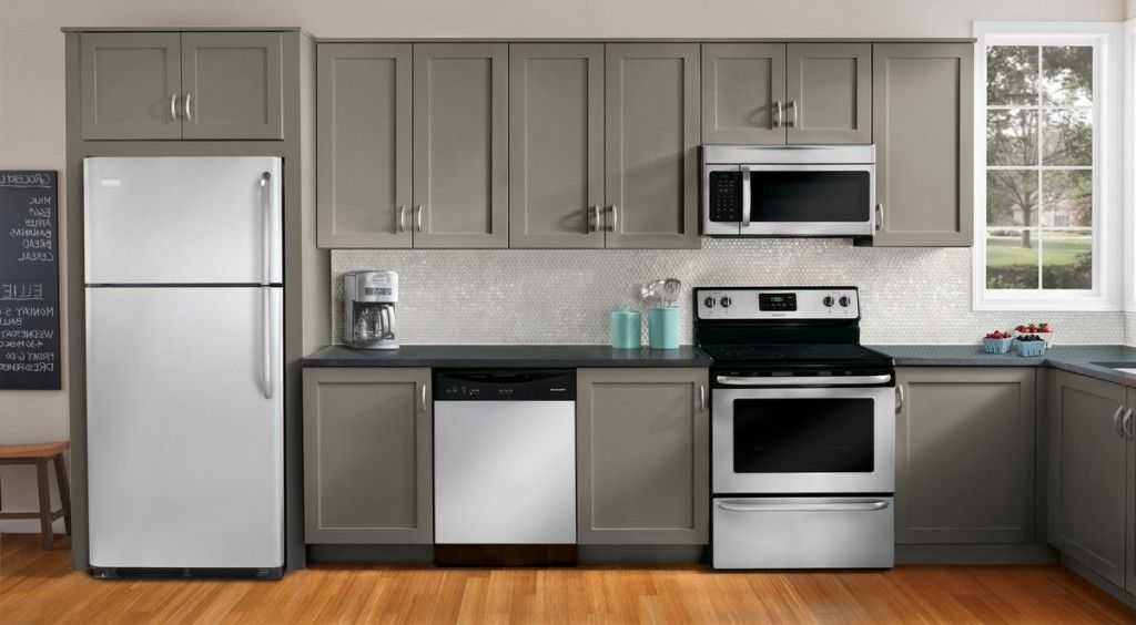 Grey themes of kitchen appliance package set on brown for Kitchen cabinet packages