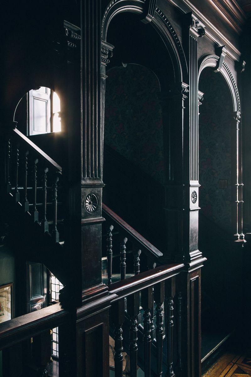 Interior Color. Black dark interior. Staircase. Milk Thistle Bar, Bristol, England