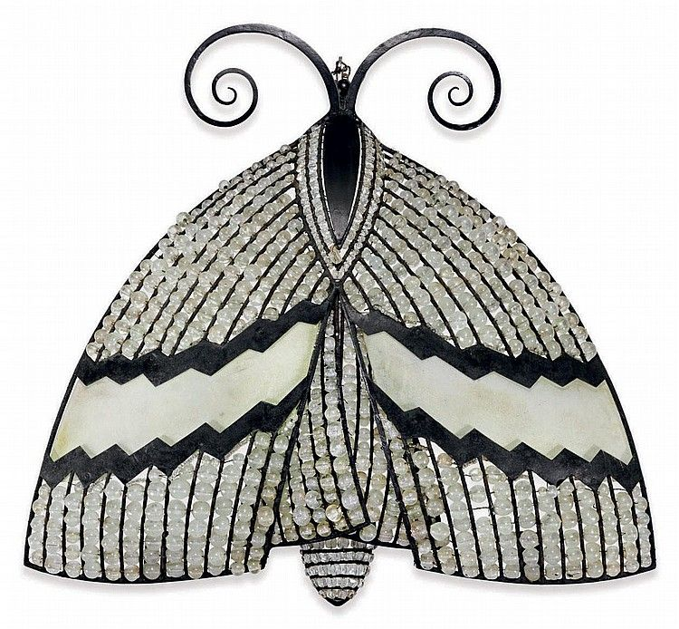ARMAND ALBERT RATEAU (1882-1938) A Patinated Metal and Glass Butterfly Sconce, circa 1925
