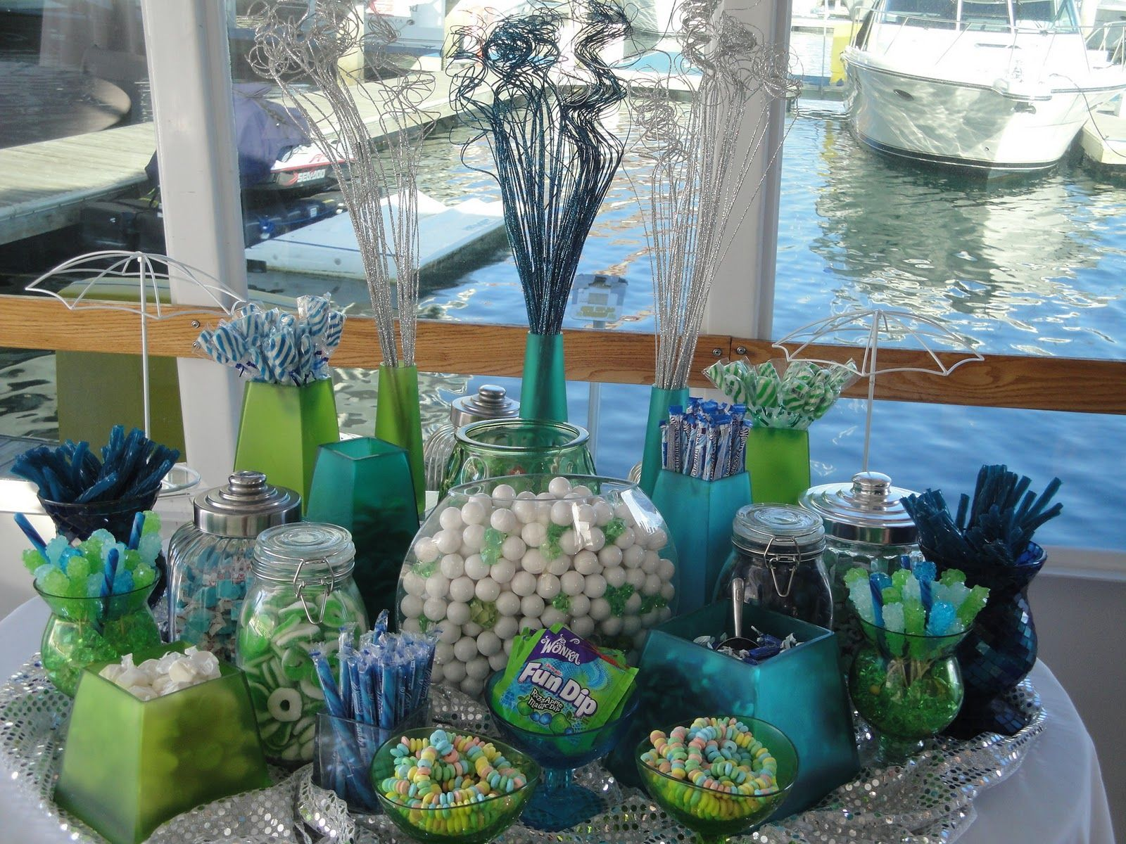 Beautiful summer colors of light blues and greens at a Sweet 16 candy table