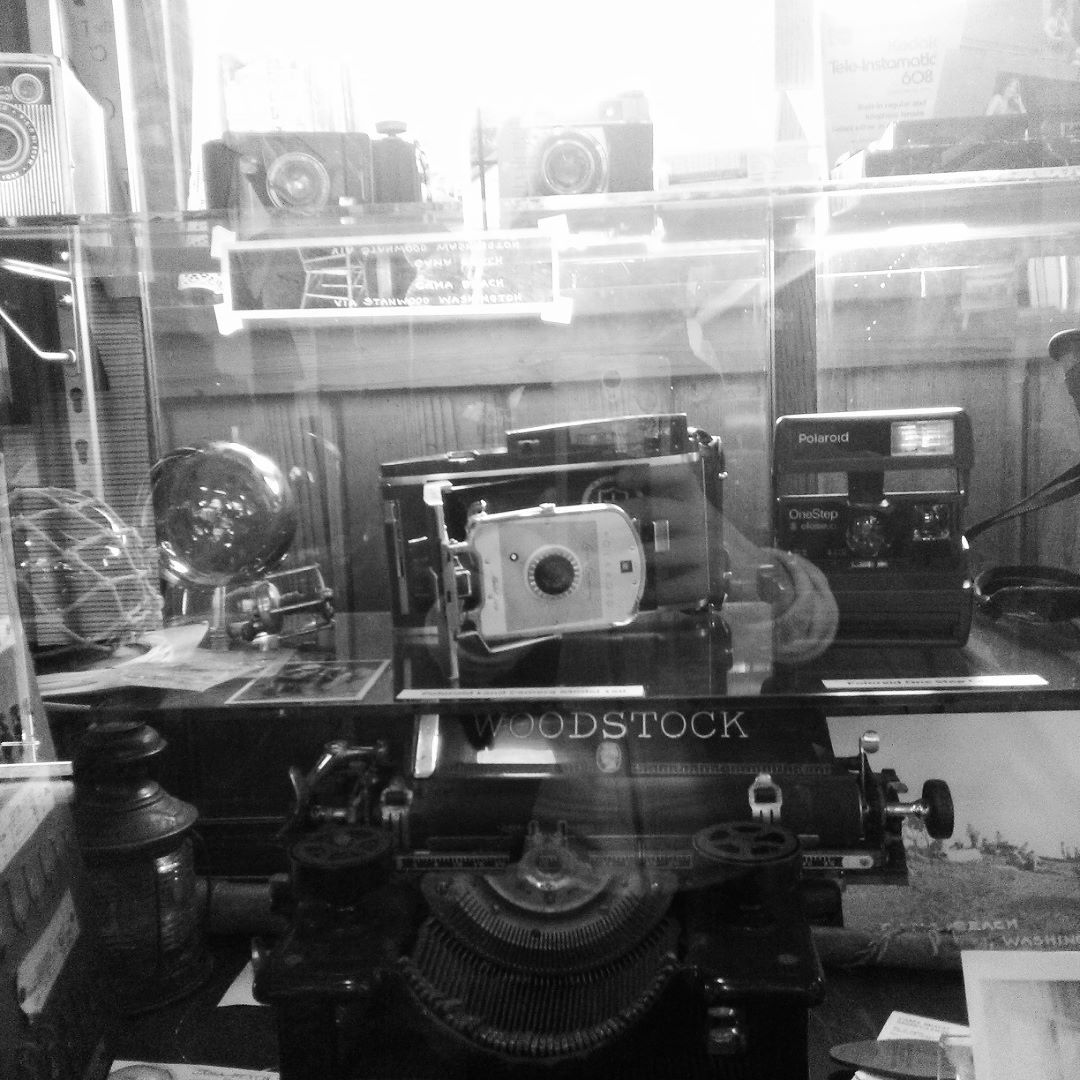 Like I said in my last post I'm camping. So I'm in the camp store and there's this glass case with all these old cameras in it. Let me tell you I LOVE old cameras!!!