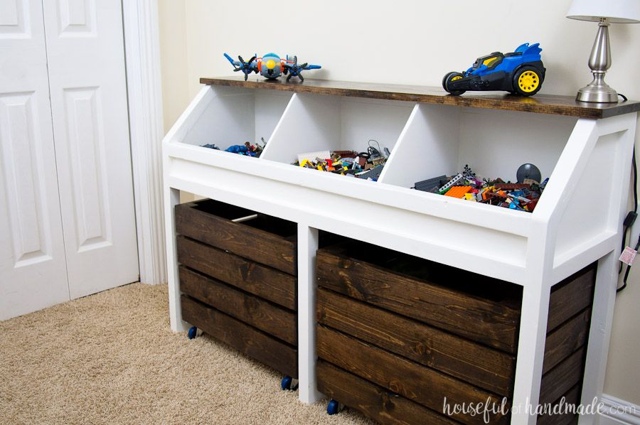 Organize The Piles Of Toys In This Toy Storage Console Three Open Bins On Top Hold Smaller Toys And Two Large Ro Diy Toy Storage Rustic Toys Toy Storage Units
