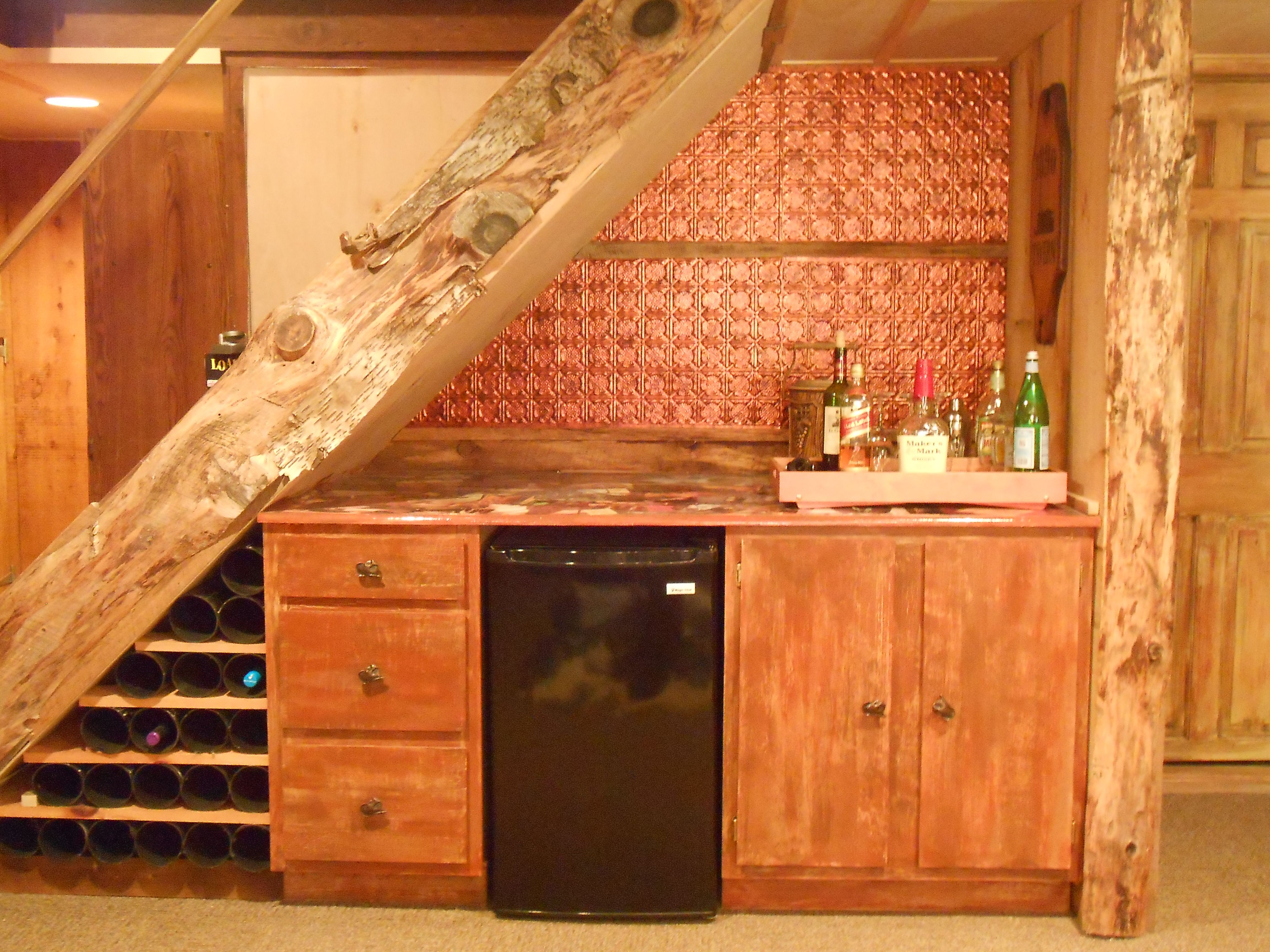 Best Use The Area Under Stairs To Build In A Bar Staircase 400 x 300
