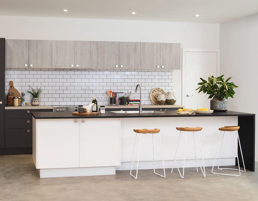 large white kitchen island with dark benchtop  kitchen