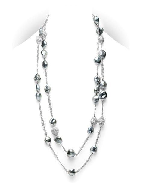 Mikimoto necklace: Baroque Tempo Necklace, baroque Black South Sea cultured pearls with pavè diamonds in organic shapes, positioned along 18k white gold chains. The total length of the necklace is 51 inches.
