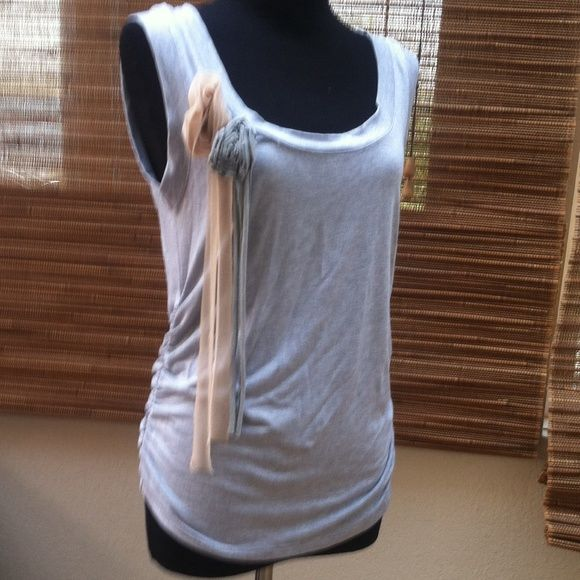 Grey tank with flower detail. Soft grey tank with gathers on each side. 92% rayon & 8% polyester. Hand wash. Made in the USA. Tops Tank Tops