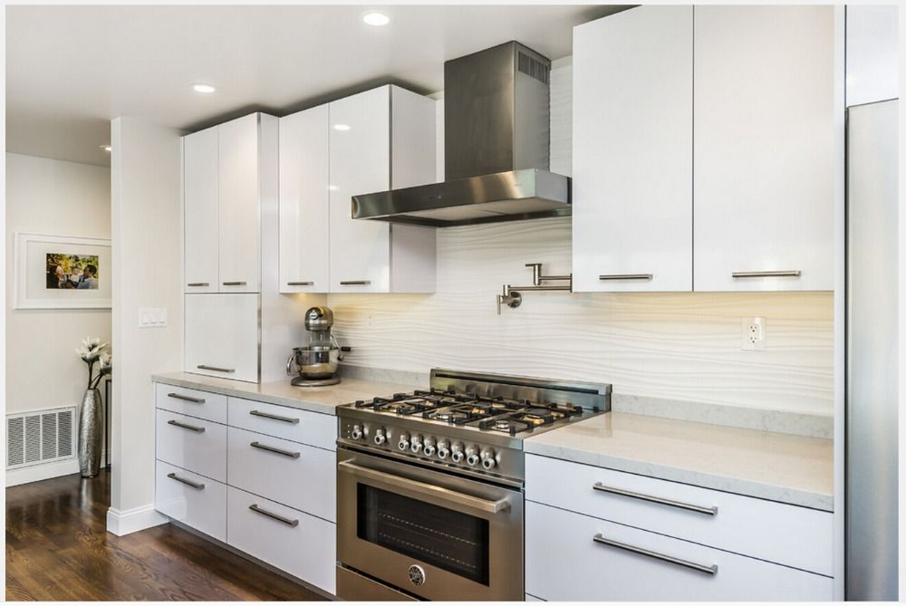 Modern Kitchen Furnitures With High Gloss White Kitchen Cabinets With Wooden Laminate Floor And White Kitchen Backsplash Stainless Steel Kitche White Gloss Kitchen Modern Kitchen Furniture High Gloss White Kitchen