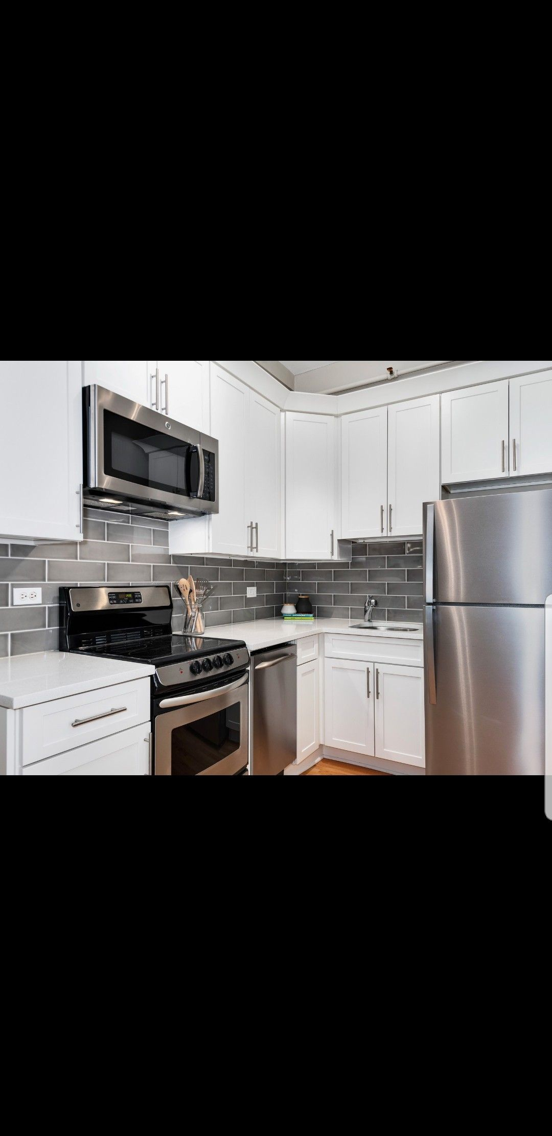 Modern Kitchen With White Cabinets Stainless Steel Appliances Grey Subway Tile Backsplash White Kitchen Rustic White Kitchen Countertops White Kitchen Decor