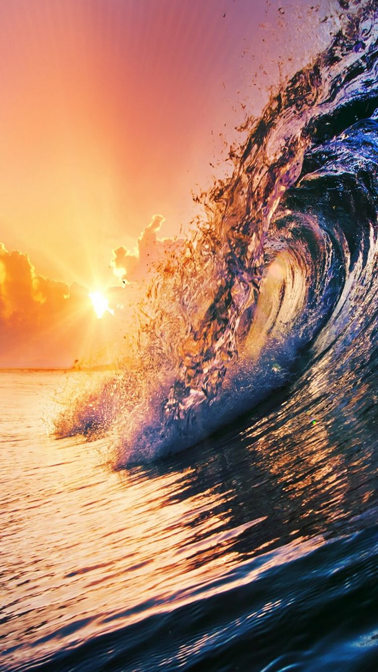 Sunset surfing waves wallpaper