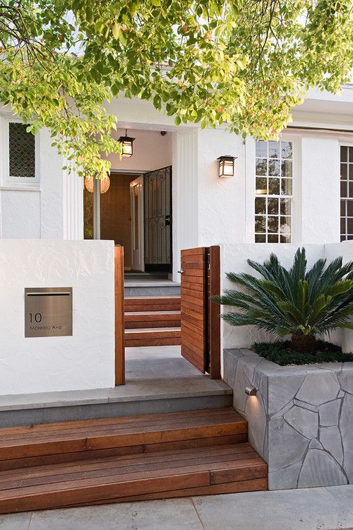 White + Wood Front Entry With A Low Gate