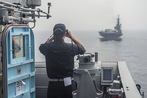 Ensign Samson Cohen finds the range and speed of the Indian Navy Centaur-class aircraft carrier INS Viraat (R22) from the bridge wing of the Ticonderoga-class guided-missile cruiser USS Antietam (CG 54) during an exercise as part of India's International Fleet Review (IFR) 2016.