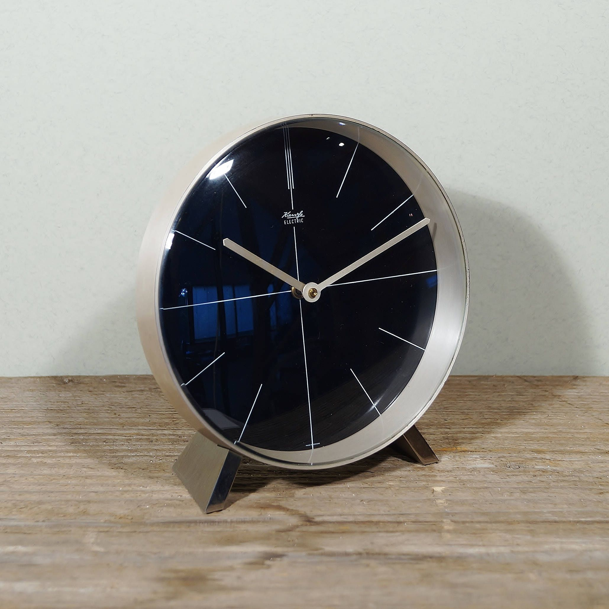 Electric table clock of KIENZLE Stainless steel and glass Germany 60 Vintage mid century clock Minimalistic design Retro Europe interior decoration