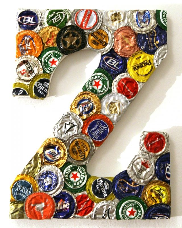a giant letter made with some left over beer caps. Make your man a monogram for his man cave?