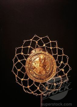 Gold brooch with female figure, from Mycenae, Grave Circle A, Tomb III.