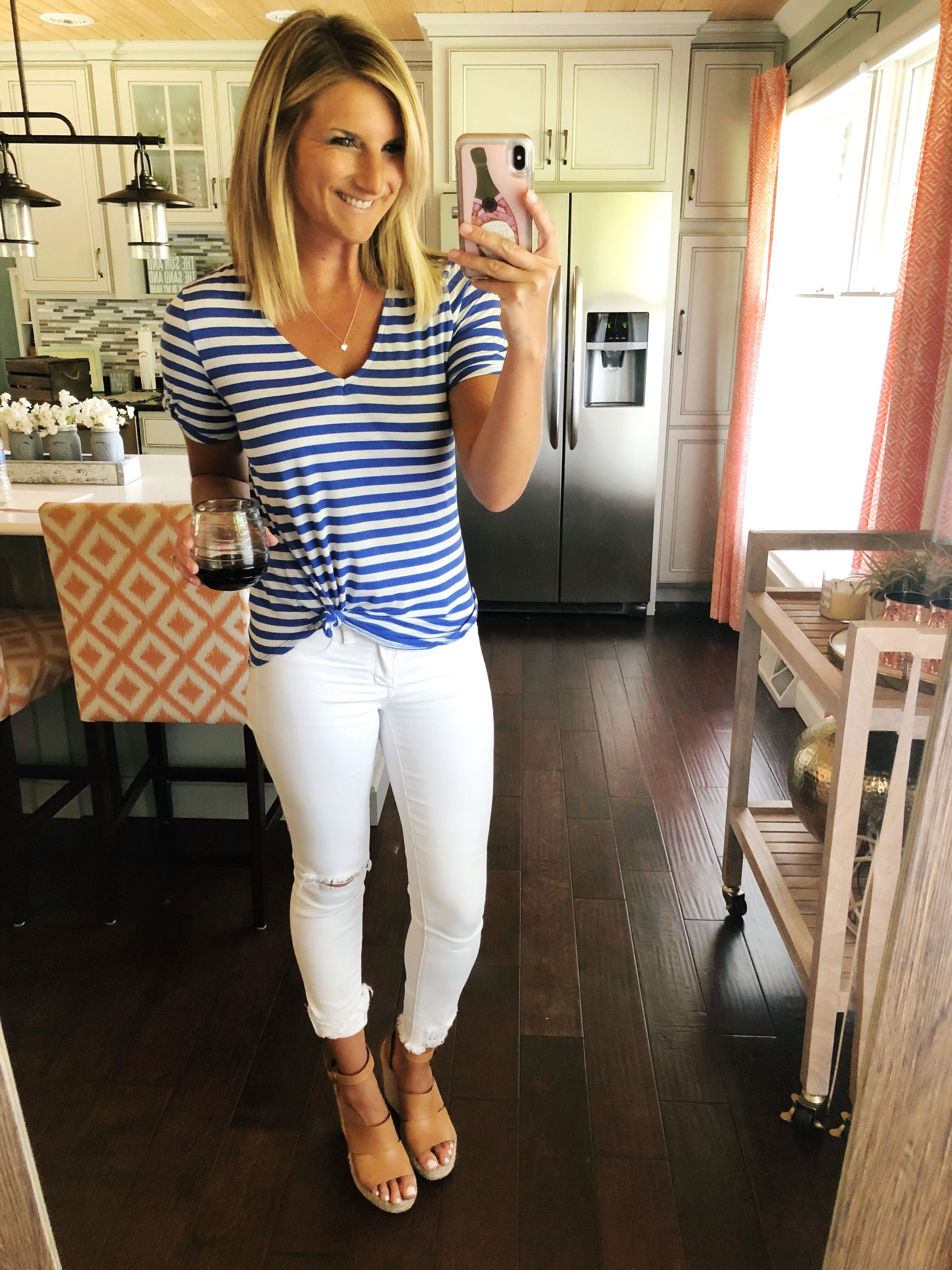 be3d9f1f9878 Simple Vacation Outfit    What to Wear on Vacation    Striped Top + White  Jeans + Slip On Sneakers    Spring Fashion    Cute Spri…