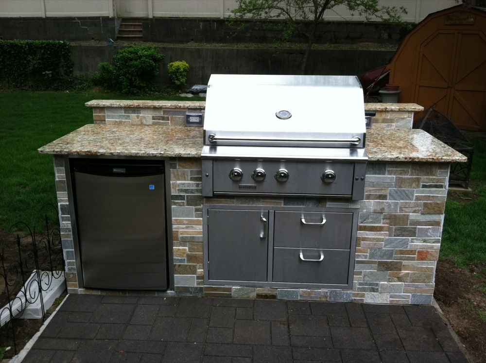 small outdoor kitchen under patio | site managedeast coast efx